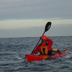 Kayaker working on bow rudder