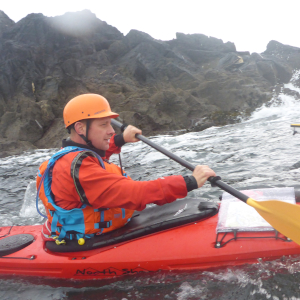 Sea kayaker in rough water
