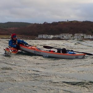 Women carrying out sea kayak rescue
