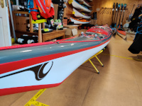 P&H Cetus MV carbon/kevlar infusion grey and red composite kayak nose view